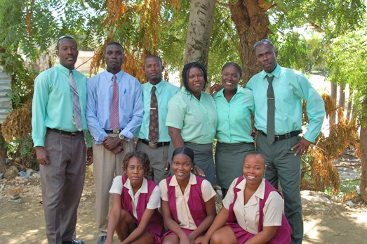 Ralph (in blue shirt) with the rest of the school staff in October 2008.